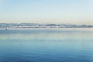 Germany, Upper Bavaria, view to Lake Starnberg with early-morning haze - TCF005087