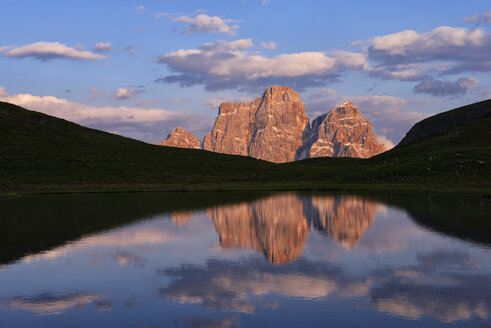 Italy, Province of Belluno, Dolomites, Selva di Cadore, Monte Pelmo at sunset - RUEF001738