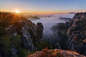 Germany, Saxon Switzerland National Park, Bastei, Hoellenhund at Raaber Kessel at sunrise - RUEF001747