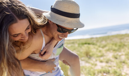 Young couple having fun on the beach - MGOF002375