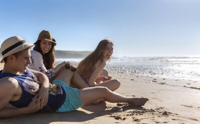 Three friends relaxing on the beach - MGOF002411