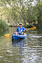 Spain, Segovia, Man in a canoe - ABZF001184