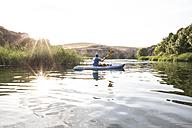 Spain, Segovia, Man in a canoe in Las Hoces del Rio Duraton - ABZF001187