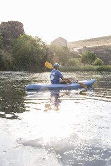 Spain, Segovia, Man in a canoe in Las Hoces del Rio Duraton - ABZF001190