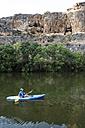 Spain, Segovia, Man in a canoe in Las Hoces del Rio Duraton - ABZF001193