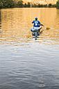 Spain, Segovia, Man in a canoe in Las Hoces del Rio Duraton - ABZF001196