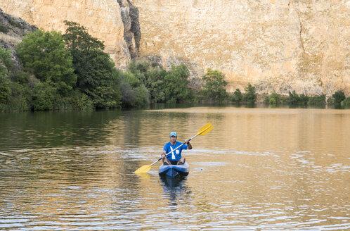 Spain, Segovia, Man in a canoe in Las Hoces del Rio Duraton - ABZF001199