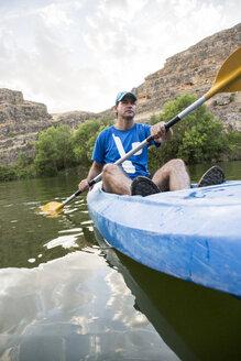 Spain, Segovia, Man in a canoe in Las Hoces del Rio Duraton - ABZF001202