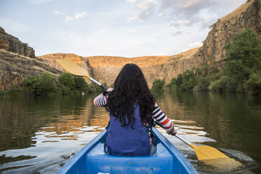 Spain, Segovia, Woman in a canoe in Las Hoces del Rio Duraton - ABZF001205