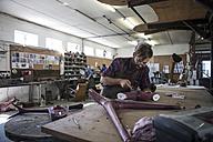 Sculptor working in studio - ZEF010181