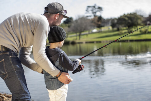 Father and son fishing together - ZEF010203