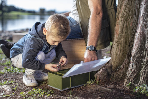 Boy with grandfather taking bait from box - ZEF010206
