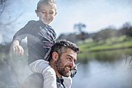 Father carrying his son on shoulders - ZEF010209