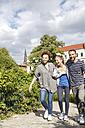 Happy friends walking in park - WESTF021736