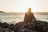 France, Crozon peninsula, woman at beach - UUF008336
