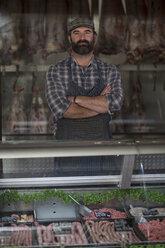 Portrait of confident butcher in butchery - ZEF010290