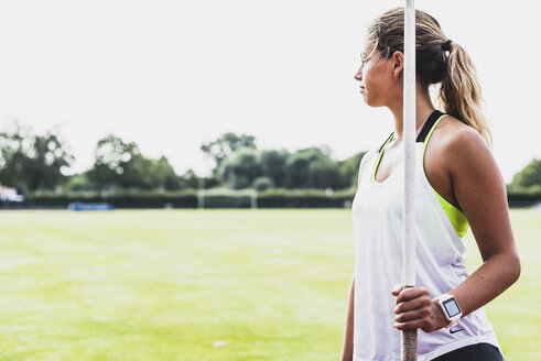 Young woman holding javelin - UUF008375