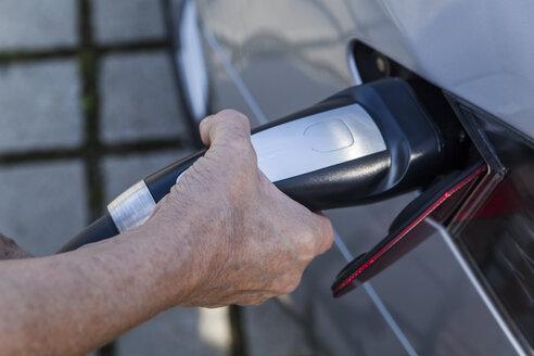 Charging of an electric car, close-up - TCF005092