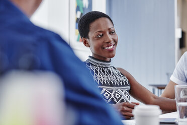 Smiling woman in a meeting - RORF00282
