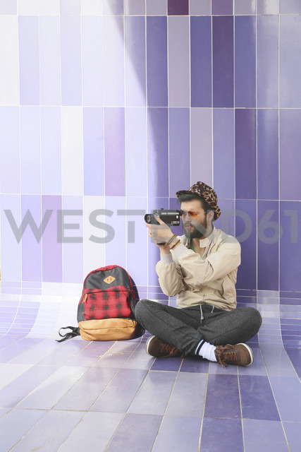 Young man using a vintage video camera - RTBF00344
