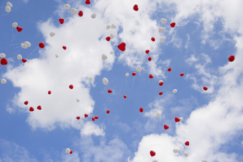 Heart-shape balloons in sky at wedding day - CRF02758