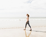 Teenage girl walking on the beach - UUF08397