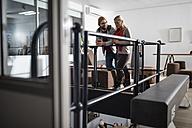 Young couple having coffee break in designer office - ZEF10349