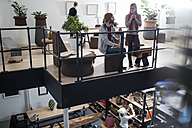 People chatting and drinking coffee in designer office - ZEF10352
