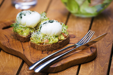 Slices of toast with mashed avocado, boiled egg and sprouts - KNTF00495
