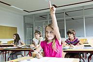 Smiling schoolgirl raising her hand - SARF02882