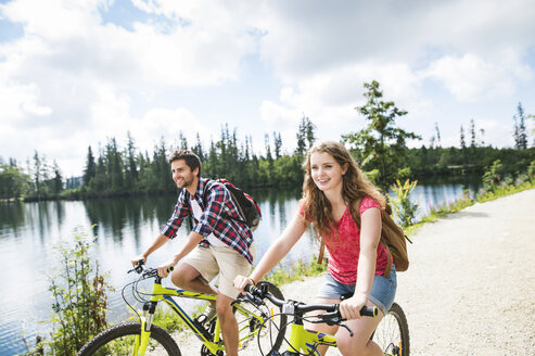 Young couple doing a bicycle trip - HAPF00845