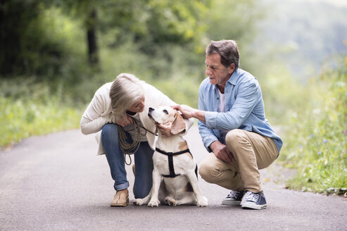 Senior couple with dog in nature - HAPF00872