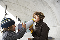 Two brothers playing with a megaphone - FSF00460