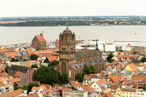 Germany, Stralsund, view to St. James' Church at the historic old town and Ruegen Island - TAMF00647