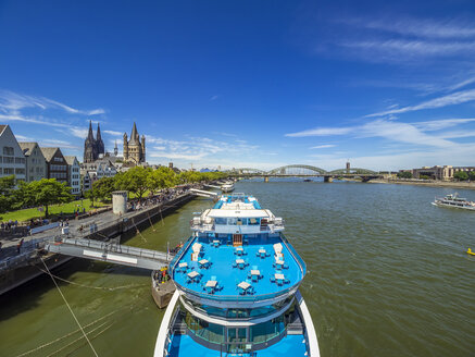 Germany, Cologne, panorma view view with tourboat on Rhine River in the foreground - KRPF01833