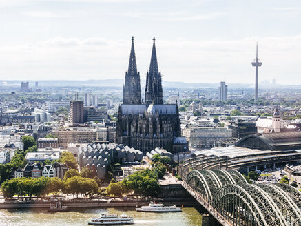 Germany, Cologne, view  to the city with Hohenzollern Bridge and Rhine River in the foreground from above - KRPF01839