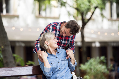 Senior man surprising senior woman - HAPF00903