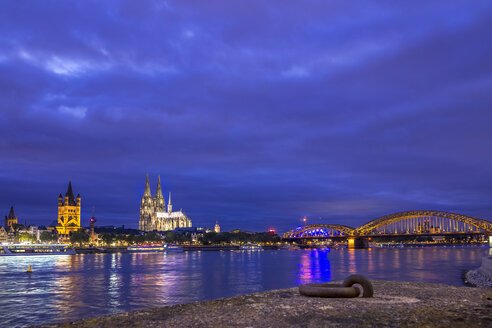 Germany, Cologne, view to the city and Hohenzollern bridge with Rhine River in the foreground - KRPF01846