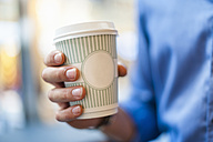 Hand holding takeaway coffee - DIGF01285