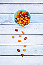 Bowl of yellow and red mini tomatoes - LVF05333