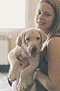 Young woman with her Labrador Retriever puppy - SKCF00197