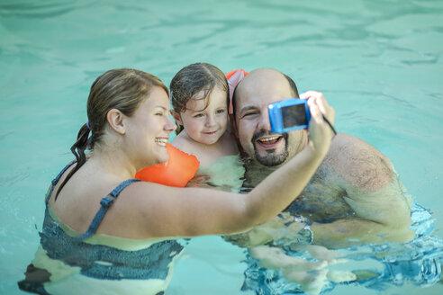 Family taking selfie in swimming pool - SHKF00676