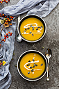 Creamed pumpkin soup in black bowl - SARF02912
