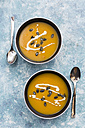 Creamed pumpkin soup in black bowl - SARF02915
