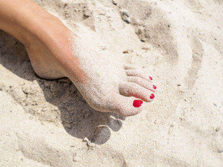 Woman's foot in the sand - LAF01746