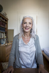 Portrait of smiling woman at home - JUNF00693