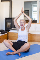 Woman practicing yoga at home - JUNF00705