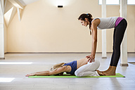 Prenatal yoga, female yoga instructor, child position - ZEDF00331