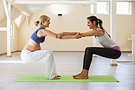 Prenatal yoga, female yoga instructor, stretching - ZEDF00346