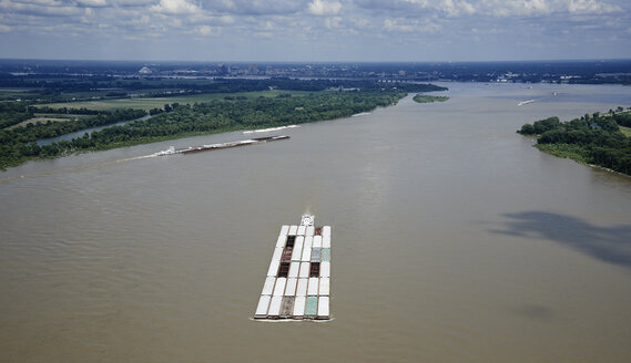 USA, Tennessee, Aerial photograph of tug and barges heading up the Mississippi River near Memphis - BCDF00050